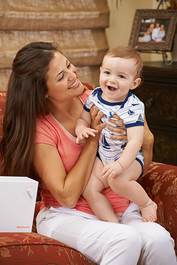 Mom and baby smiling after using BabySmile nasal aspirator